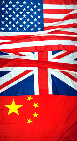 American, UK and Chinese flags arranged in order that can be used to show order of countries winning the games. America first with gold, United Kingdom second with silver and China third with bronze.