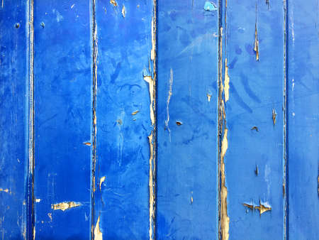 Blue wooden background with peeling paint which can be used as a background for text. Shade of blue is the color of American flag blue and can be used for backgrounds for text about America.