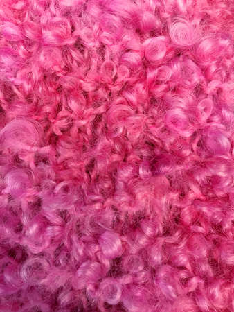 Fluffy pink wool which can be used as a background. Space for text. Imagens