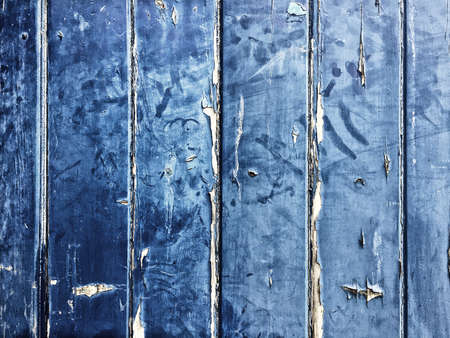 Blue wooden background with peeling paint and vintage effect and space for text.