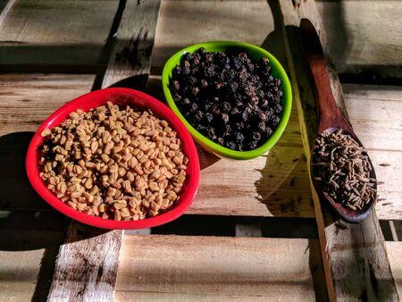 fenugreek, pepper and cumin seeds
