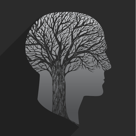 telepathy: Tree in the shape of head on dark background