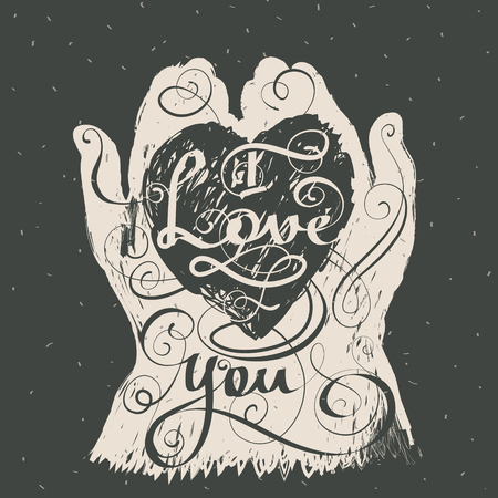I love you, written in heart in hands shape silhouette on blackboard. Hand drawn lettering romantic inspiration quote.