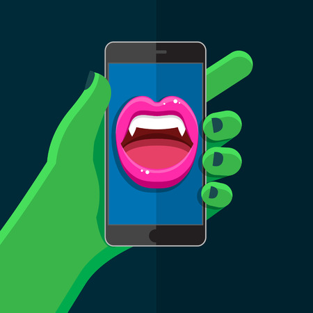 vamp: Halloween concept. Green hand holding a phone with speaking Vampire mouth with open red lips and fangs on display. Illustration