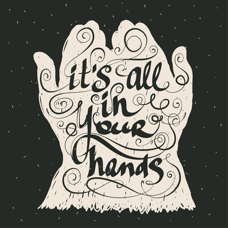 all in: It is all in your hands. Hand drawn calligraphic inspiration quote on blackboard.