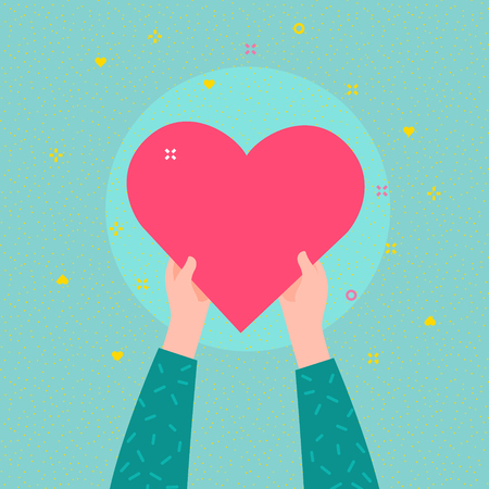 Charity concept. Hands are holding big heart symbol.