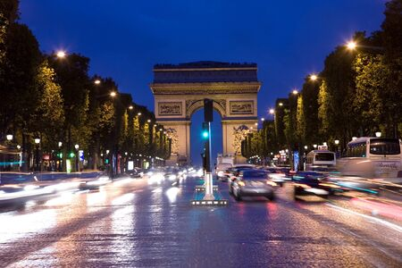 Paris, France - September 26, 2010: Arc de triumph seen from the avenue des Champs-Elysees in night.