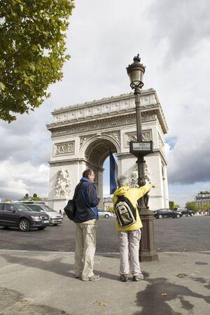 Paris, France - September 25, 2010: Tourist visiting Paris enjoy their day trip around Paris most famous monument Arc de triumph