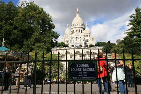 Paris, France, September 24, 2010 - There are some tourist walking around Basilica of the Sacre C��ur on bright sunny day.