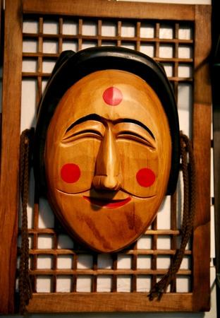 labelled: Seoul, South Korea - April 23, 2011: Wooden Hahoe Mask, Hahoetal in Korean, in Insadong. Hahoe masks are labelled South Korean national treasure.
