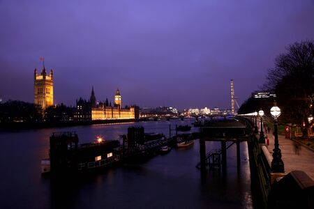 London, UK - March 1, 2011: London Eye and Westminster in the distance seen from Vaxuhall Bridge at dusk.  Stock Photo - 10052071