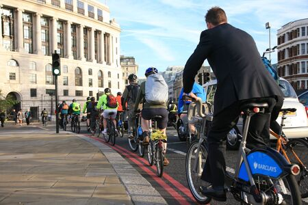 blackfriars bridge: London, UK - October 2, 2010 - Bicycle commuters on their way to work after crossing Blackfriars bridge in early morning.  Editorial