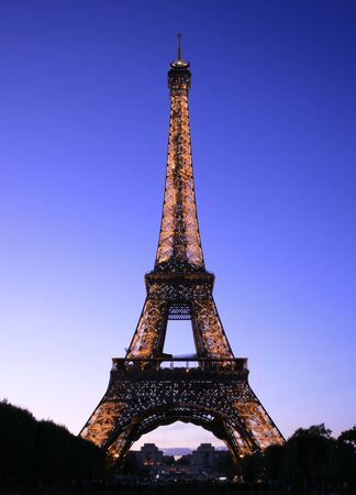 Paris, France - September 25, 2010: Eiffel tower at night. This prominent tower was built in 1889 and is the most iconic symbol of Paris and France.   Stock Photo - 10086394