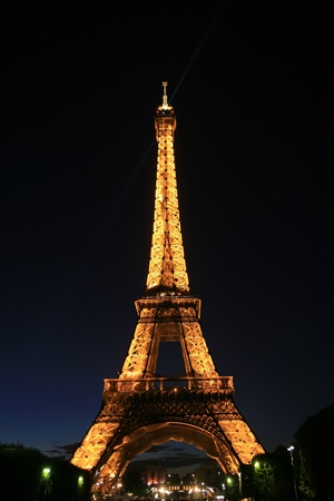 international landmark: Paris, France - September 25, 2010: Eiffel tower at night. This prominent tower was built in 1889 and is the most iconic symbol of Paris and France.