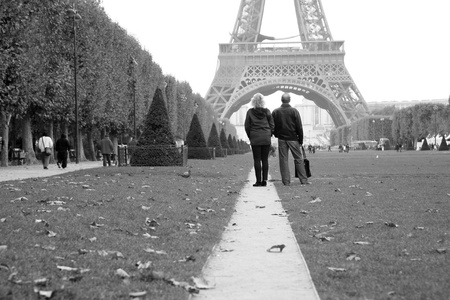 Paris, France - September 27, 2010: Couple tourist watching the Eiffel Tower in distance. This prominent tower was built in 1889 and is the most iconic symbol of Paris and France.   Stock Photo - 10086406