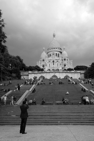Paris, France, September 24, 2010- Tourist takes photographs Basilica of the Sacre C��ur