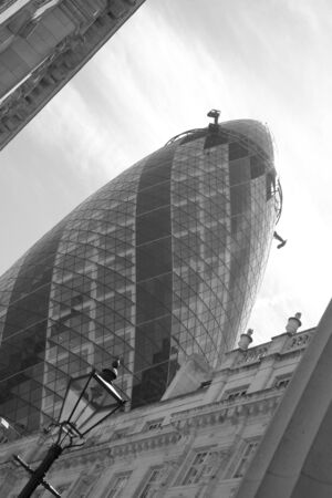 London, UK - May 25, 2011: Outsid view of 30 St Mary Axe, likely being called Gherkin, 30 St Mary Axe was completed in December 2003 and now this is one of the most iconic modern buildings in London.  Stock Photo - 10164924