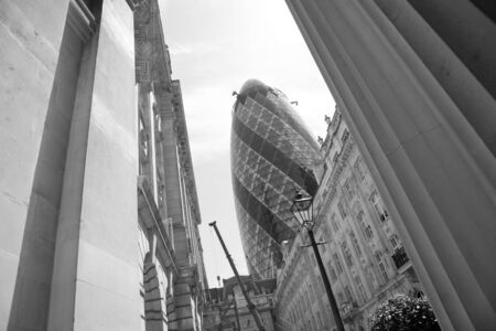 London, UK - May 25, 2011: Outsid view of 30 St Mary Axe, likely being called Gherkin, 30 St Mary Axe was completed in December 2003 and now this is one of the most iconic modern buildings in London.  Stock Photo - 10164926
