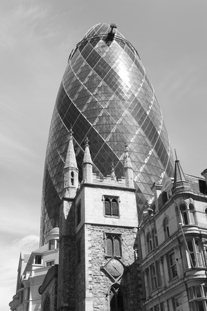 London, UK - May 25, 2011: Outsid view of 30 St Mary Axe, likely being called Gherkin, 30 St Mary Axe was completed in December 2003 and now this is one of the most iconic modern buildings in London.  Stock Photo - 10164931