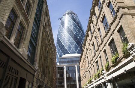 London, UK - May 25, 2011: Outsid view of 30 St Mary Axe, likely being called Gherkin, 30 St Mary Axe was completed in December 2003 and now this is one of the most iconic modern buildings in London.  Stock Photo - 10164950