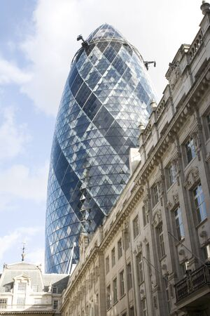 London, UK - September 16, 2010: Outside view of 30 St Mary Axe, likely being called Gherkin, 30 St Mary Axe was completed in December 2003 and now this is one of the most iconic modern buildings in London.  Stock Photo - 10164940