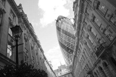 30 st mary axe: London, UK - September 16, 2010: Outside view of 30 St Mary Axe, likely being called Gherkin, 30 St Mary Axe was completed in December 2003 and now this is one of the most iconic modern buildings in London.  Editorial