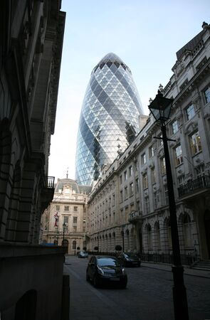 London, UK - April 21, 2010: Outside view of 30 St Mary Axe, likely being called Gherkin, 30 St Mary Axe was completed in December 2003 and now this is one of the most iconic modern buildings in London.  Stock Photo - 10164918