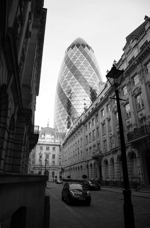 London, UK - April 21, 2010: Outside view of 30 St Mary Axe, likely being called Gherkin, 30 St Mary Axe was completed in December 2003 and now this is one of the most iconic modern buildings in London.  Stock Photo - 10164916