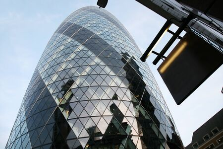 London, UK - April 21, 2010: Outside view of 30 St Mary Axe, likely being called Gherkin, 30 St Mary Axe was completed in December 2003 and now this is one of the most iconic modern buildings in London.  Stock Photo - 10164923
