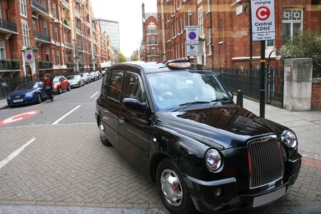 Taxi in the street of London. Cabs, Taxis, are the most iconic symbol of London as well as London