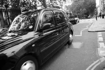 Taxi in the street of London. Cabs, Taxis, are the most iconic symbol of London as well as London Stock Photo - 10321743