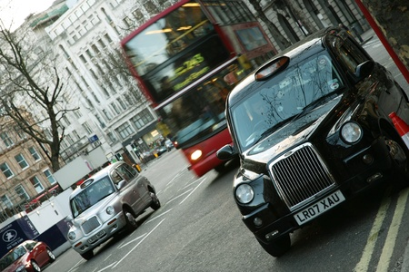 London, UK - January 30, 2011: Taxi in the street of London. Cabs are the most iconic symbol of London as well as London