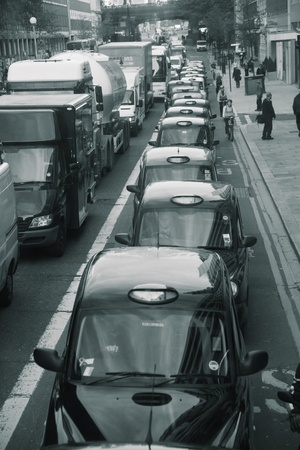 London, UK - October 07, 2010: Taxis in the street of London. Cabs are the most iconic symbol of London as well as London