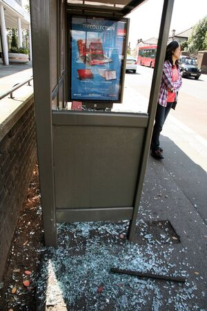 anti social: London, UK - June 11, 2011: Smashed glass on a local bus stop, anti social behavior is quite on issue in the UK.