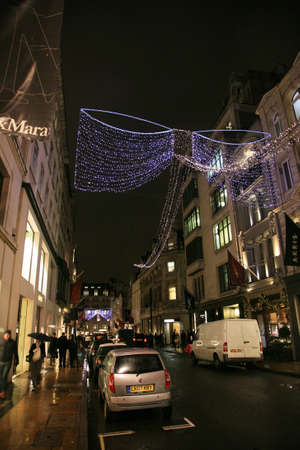 bond street: London, UK - December 16, 2010: Street Night View of Bond Street with Christmas Decoration. Bond Street is one of the most famous shopping street in London and also famous for its beautiful Christmas Decoration.