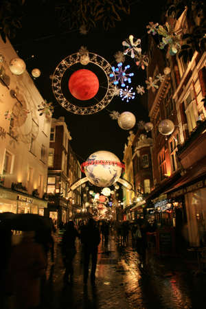 London, UK - December 16, 2010: Street Night View of Carnaby Street with Christmas Decoration. Carnaby Street is well known shopping area and it is also famous for it's beautiful Christmas Decoration.   Stock Photo - 10591789