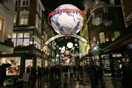 London, UK - December 16, 2010: Street Night View of Carnaby Street with Christmas Decoration. Carnaby Street is well known shopping area and it is also famous for it's beautiful Christmas Decoration.   Stock Photo - 10591793