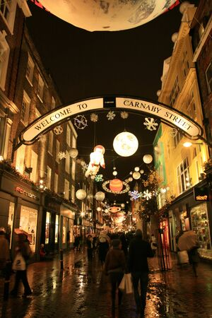London, UK - December 16, 2010: Street Night View of Carnaby Street with Christmas Decoration. Carnaby Street is well known shopping area and it is also famous for it's beautiful Christmas Decoration.   Stock Photo - 10591781
