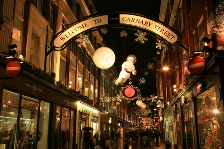 London, UK - December 16, 2010: Street Night View of Carnaby Street with Christmas Decoration. Carnaby Street is well known shopping area and it is also famous for its beautiful Christmas Decoration.