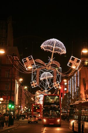 London, UK - November 21, 2010: Street Night View of Oxford Street with Christmas Decoration. Oxford Street is one of the most famous shopping street in London and also famous for it's beautiful Christmas Decoration.   Stock Photo - 10591779