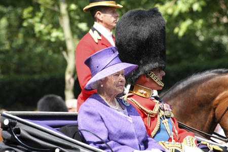 queen elizabeth: London, UK - June 17, 2006: Queen Elizabeth II and Prince Philip seating on the Royal Coach at Trooping the colour ceremony, also known as the Queens Birthday Parade