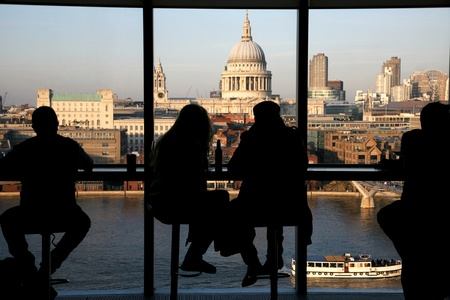 the place of interest: A couple tourists over looking St Pauls Cathedral from Tate Modern