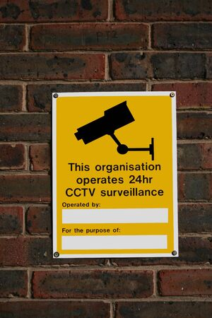 under surveillance: Caution street sign with CCTV surveillance sign.  Stock Photo