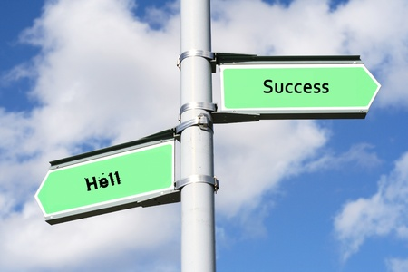 Street post with Success, Hell  signs.  photo