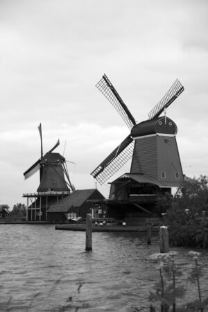 Windmills of Zaanse Schans, North Holland. Zaanse Schans is famous for its collection of well-preserved historic windmills and houses photo