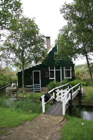 schans: Zaanse Schans, Netherlands - June 20, 2010: Traditional house in Zaanse Schans, North Holland. Zaanse Schans is famous for its collection of well-preserved historic windmills and houses