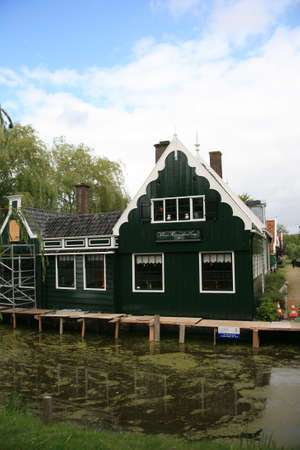 zaanse: Zaanse Schans, Netherlands - June 20, 2010: Traditional house in Zaanse Schans, North Holland. Zaanse Schans is famous for its collection of well-preserved historic windmills and houses