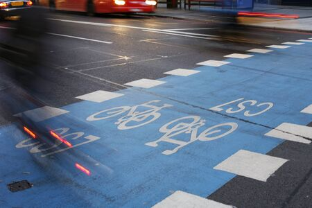 super highway: Bicycle lane with white mark of bicycle sign, London.     Stock Photo