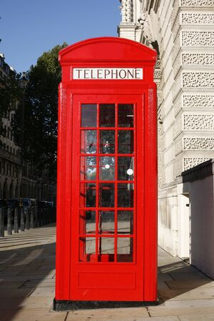 Red phone booth is one of the most famous of London icons photo