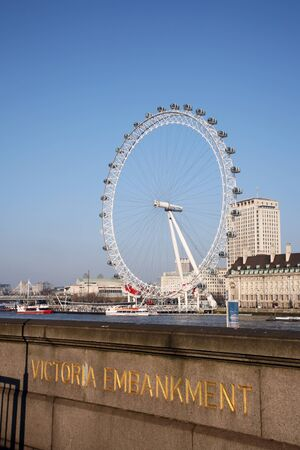 London, UK - March 04, 2011: View of the London Eye, a famous tourist attraction, seen from Victoria Embankment.
